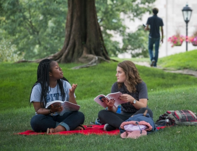 Students Sitting in Cathedral Lawn
